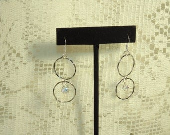 Sterling Silver Earrings With Beautiful Hammered Rings, Swarovski Crystals, And Sterling Silver Hooks -  FREE SHIPPING.