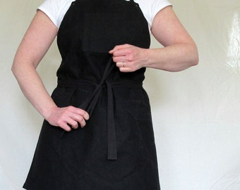 Solid black canvas apron - reinforced with rivets - chest pocket with thermometer or pen slot