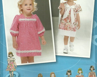 Simplicity 2674 Sewing Pattern, Toddlers' Dress with Sleeve and Trim Variations, Size 1/2, 1, 2, 3, 4, Uncut Project Runway Inspired.