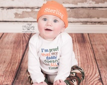 I'm proof that my DADDY doesn't hunt all the time bodysuit, leg warmers and hat.  Can customize colors