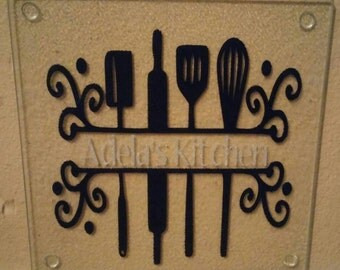 Personalized glass cutting board with split utensils
