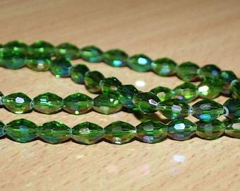 Crystal green beads bi-cone. Faceted glass bi cone.