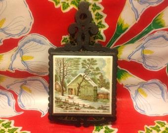 Vintage cast iron and tile trivet- The Old Homestead- Japan