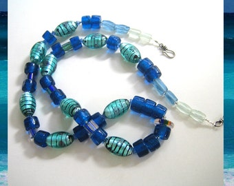 Cobalt Wampum: Hand-blown, dichroic and vintage glass, Necklace and choice of earrings.