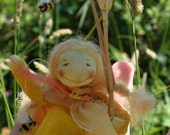 A Sunshine fairy dancer, this summer sprite with tiny bees will join your children's imaginative playtime and grace your nature table