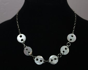 Shell button and silver necklace