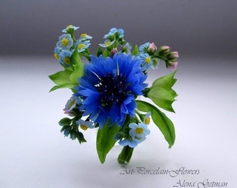 Brooch with cornflowers and forget-me .