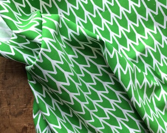 Bright Green design printed on white Kona cotton. Hand screen printed fabric.
