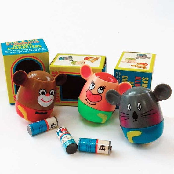 New Spin Toys : Items similar to vintage spinning mouse toy s