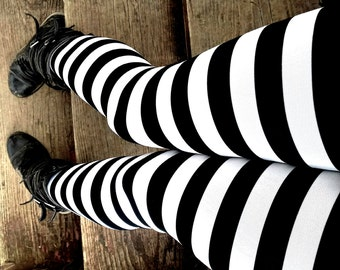 I'll get you my pretty Black and white stripe Leggings pants