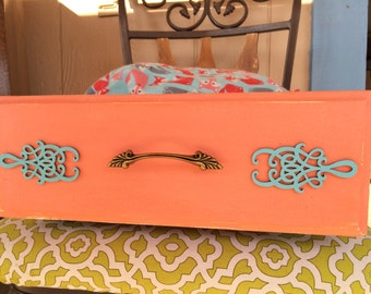 Foxy print peach and turquoise pet bed in a drawer