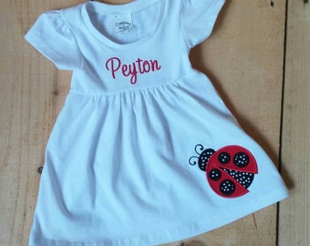 Personalized White Cap Sleeve Cotton Dress with Ladybug and Monogrammed Name or Monogrammed Initials. Size 3 months-4T