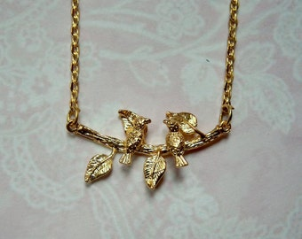 Delicate birds on branch gold chain