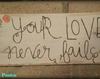 Your love never fails wood sign