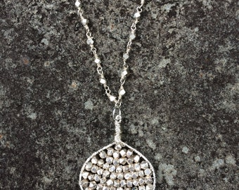 Handwoven silver plated nugget pendant on pyrite and sterling silver chain