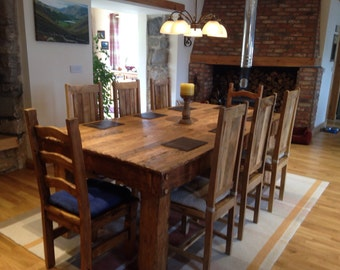 Rustic handmade dining table made from reclaimed hardwood
