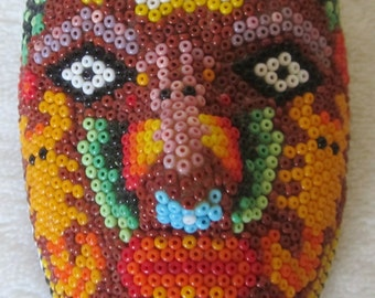 Huichol Mexican Mask is captivating with intricate designs vibrant colors & sacred symbols. Made with tiny seed beads. A great manly gift .