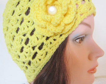 Yellow Cloche -hand crochet using a variation of an open-shell stitch. A yellow rose motif is attached with a vintage button at it's center.