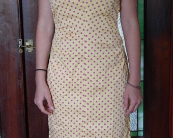 Yellow strapless dress with pink polka dots
