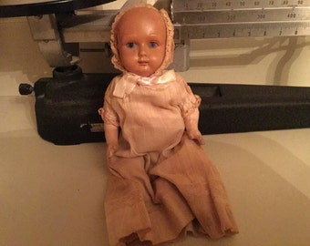 Antique Baby Doll:  Antique German Rheinische Celluloid Fab.co. baby doll with celluloid head, composite torso and limbs, doll clothes