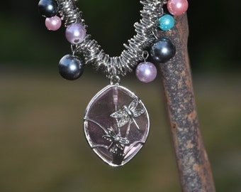 multi colored pearl necklace with pink pendant