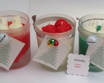 Christmas scented candles with snowman wax moulds, available with a black gift box