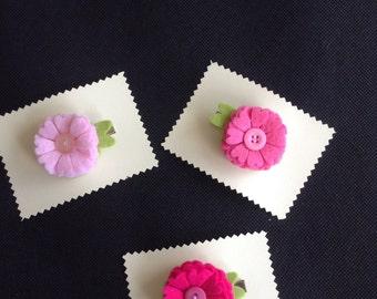 Felt flower primrose style hair clips in pink