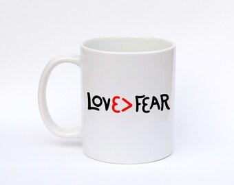 Coffee mug, love is stronger than fear, love > fear