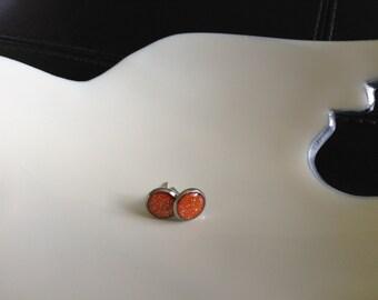 Little rays of glitter sunshine 10mm silver post earrings. Glitter makes everything feel better.