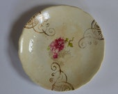Small gold embossed floral ring dish