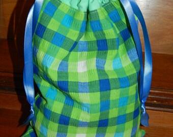 Fully lined, reversible, drawstring bag
