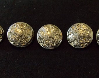 5 Silver-colored buttons. Perfect for a lady's jacket, or....