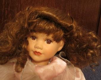 "Porcelain Red Headed doll Marked ""Rose"" on neck"