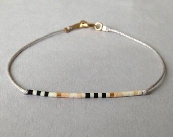 Friendship bead bracelet / Delicate layering bracelet / Light lilac grey
