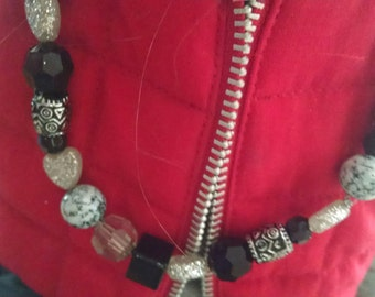 28 inch beaded necklace with black and silver tones
