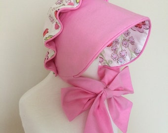 Floral and Pink Reversible Ruffle Button Bonnet