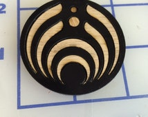 Bassnectar 3rd gen logo cut from black acrylic with wood iserts