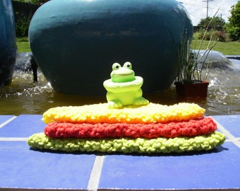 Frog and child's washcloth in primary colors