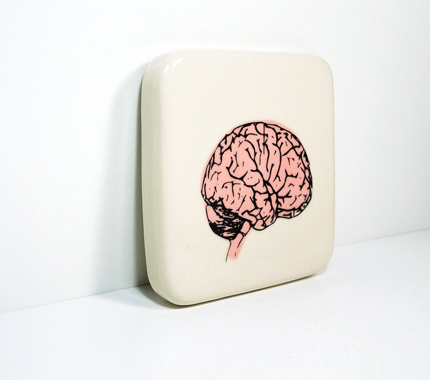 art tile / trivet in natural with a pink brain print. Made to Order.