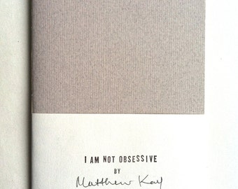 I AM NOT OBSESSIVE type writer printed zine | artist's book | decorative text