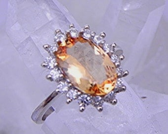 AAAA Natural Untreated Golden Imperial Topaz 11x8mm 2.74 Carat 14K or 18K white gold ring set with .60cts of diamonds  1953
