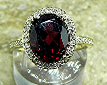 AAA Pyrope Garnet 3.10 Carats 10 X 8mm. in a 14k Yellow gold ring with diamonds (.32ct) Ring 1817