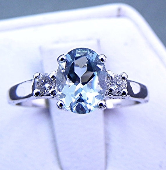 AAA Blue Aquamarine   8x6mm  1.2 Carats   with .14 cts of Diamonds 14K white gold ring