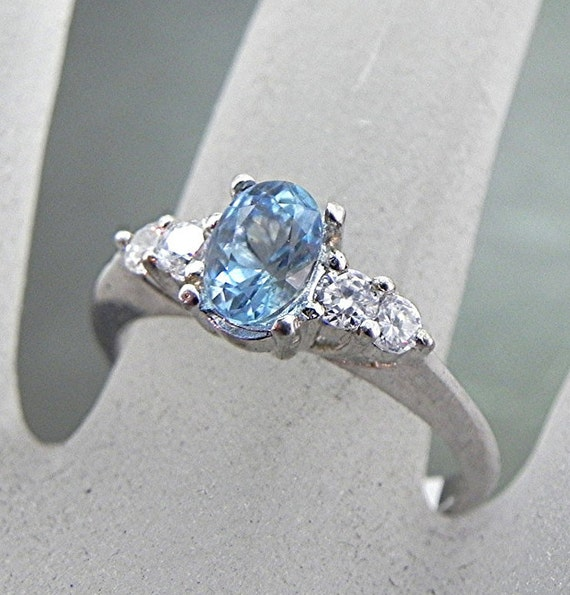 AAAA Blue Aquamarine .77 carats 7x5mm in 14K white gold ring with White sapphire accents 0976
