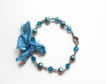 Blue fresh water pearl and teal crystal bracelet