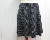 Semicircular skirt, short and flared skirt, white polka dots on black, polyester and spandex jersey, elastic waistband, XS