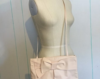 Pink 80's purse with a Bow