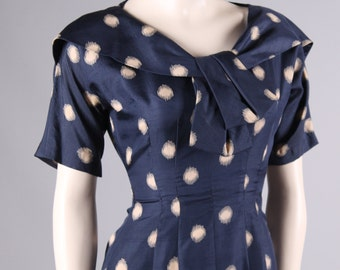 vintage 1950s blue polka dot dress Leslie Fay bow tie day dress mad men pin up bombshell size small