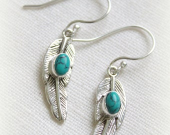 Dangle silver Feather earrings with a turquoise stone center Boho chic Ethnic Gypsy Native american designed by Inali