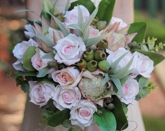 Binna Burra - weddings bouquet of Australian native proteas, gumnuts, eucalyptus leaves, spinning gum and roses.
